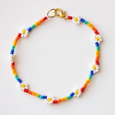 """A rainbow daisy beaded bracelet for 365 days a good vibes. This super cute piece is our summertime staple and love it layered with a few more beaded bracelets for the ultimate stack. Beads Nickel free clasp Length 6.5"""" Pony Bead Bracelets, Diy Beaded Bracelets, Cute Bracelets, Diy Necklace, Making Bracelets With Beads, Handmade Bracelets, Beaded Friendship Bracelets, Jewelry Bracelets, Embroidery Bracelets"""