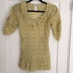 Sam and Max yellow and brown top {•} Gorgeous yellow button up shirt has ruffles at neckline and nice detail at hem. Brown floral pattern. Feminine and beautiful. Ties in the back for an adjustable fit Sam & Max Tops Blouses