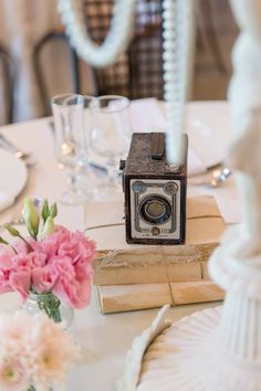Vintage bookstacks and camera to rent from moidecor.co.za/hiring - pic courtesy of Lightburst Photography