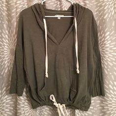 """3/4 sleeve hooded """"crop"""" Olive green color. 3/4 sleeve, and is short to fit right at waist line American Eagle Outfitters Tops"""