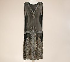 Black Chiffon Chemise Dress 1920s Sleeveless, the V-neck, low waist and sides embroidered with silver and gold sequins and bugle beads, the skirt with castellated hem and cutouts, embroidered with same in stylized floral and geometric pattern