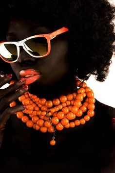 Brown beauty - dark brown-skinned girl, with afro-curly hair, bright chunky mandarin colour necklace, orange lips and sunglasses. Afro Punk, Foto Fashion, Orange You Glad, Portraits, Foto Art, My Black Is Beautiful, Orange Crush, Orange Is The New Black, Orange Brown
