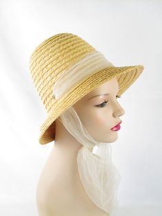 Vintage straw hat from the late 1960s - 1970s. Crown has the slits for the white chiffon scarf which forms a front hat band then ties under the