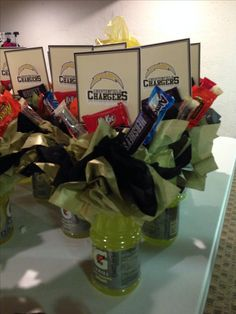 Inspiration from a fellow pinner... Made these with other football Moms - center pieces for the banquet. Football Treat Bags, Football Snacks, Football Banquet, Football Cheer, Football Baby, Team Snacks, Football Spirit, Raiders Football, Cheer Snacks
