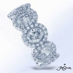 Platinum wedding band handcrafted with 5 bezel-set oval diamonds, each encircled by micro pave.