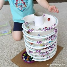 How to Build a Paper Plate Spiral Marble Track – Frugal Fun For Boys and Girls - Spielzeug Indoor Activities, Toddler Activities, Preschool Activities, Marble Tracks, Diy For Kids, Crafts For Kids, Stem Projects, Homemade Toys, Raising Kids