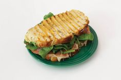 Introducing: Fika, a charming new café in Kensington Market from Victor Barry and Nikki Leigh McKean - Gallery | torontolife.com - Mortadella panini: potato-rosemary bread with mortadella, gruyere, watercress and Dijon.