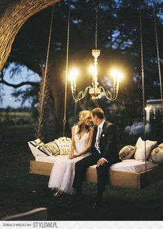 Rustic wedding decor - love the swing and chandelier