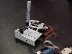 Plotclock, A Robotic Clock That Writes the Time with a Marker