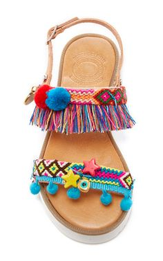 This **Elina Linardaki** Jelly Belly decorated sandal is rendered in leather and features an anatomic sole and is embellished with pom poms, friendship macrames and semi precious stones.