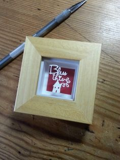 This little papercut is cut from a single sheet of cream textured paper. Magically floating over a red background casting pretty shadows.Handmade beech wood, magic box frame 8x8cm in total, finished with the engraved Paper Panda plaque on the reverse.Boxed with a signed certificate of authenticity. (Effective from September 2014)Please display away from heat sources.