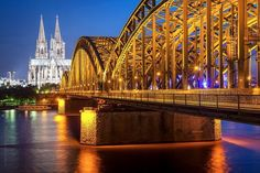 Hohenzollern Bridge and the Dome of Cologne, Germany. Photo by Wichan Yingyong-somsawas.