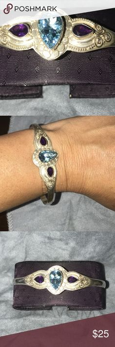 Sterling silver bangle bracelet with 3 stones. Sterling silver (stamped 925) bracelet with beautiful detail and 3 stones (2 purple and 1 blue turquoise). Great with Jeans, or a dress. Great conversation and accent piece. Smoke free pet free home silver dragon Jewelry Bracelets