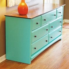 A coat of paint turned a boring black dresser into a fun turquoise entry table.