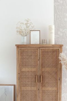 Natural neutral interior with rattan cupboard. May Pinterest: Top 15 Pins - Chloe Dominik