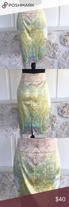 "Antonio Melani green, blue, & tan pencil skirt Antonio Melani beautiful paisley print pencil skirt with hues of green, blue, tan and cream. Fully lined, very well taken care of, EUC like NEW, back zipper and hook and eye closure, 4"" back slit in center back. measurements: waist measured laying flat side to side 18""length from waist to hemline 23"" ✅I ship same or next day ✅Bundle for discount ANTONIO MELANI Skirts Pencil"