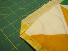 The Easiest Cheat for Binding a Quilt | Prudent Baby (uses the backing folded over as the binding)