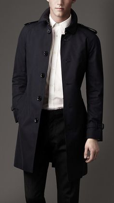 Mid-Length Trench Coat for a Man. Love the clean military shoulder detail.