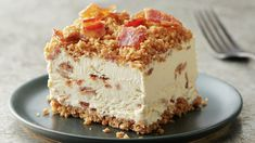 A frozen treat with a crunchy granola bar crust and creamy cheesecake-style center, speckled with brown sugar bourbon bacon.