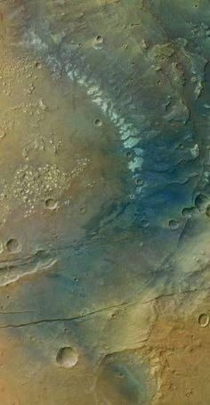 The Sirenum Fossae Region of Mars Mars Express sent back this view of Sirenum Fossae and the hills of Simois Colles, which are seen on the left side near the middle of the image. ESA / G. Neukum (Freie Universitaet, Berlin, Germany) / Processed by Bill Dunford