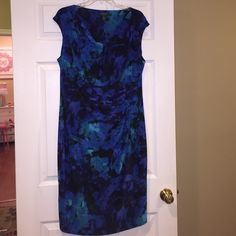 Dress This is a beautiful Ralph Lauren dress. I wore it one time and it is literally brand new with no signs of being worn. Just a gorgeous and comfortable dress. Very flattering. Ralph Lauren Dresses Midi