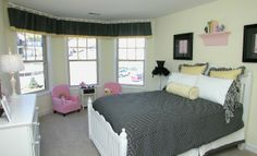 Complete with furniture for a child's smaller friends, this kid's room from Lennar Atlanta in James Creek is simply sweet