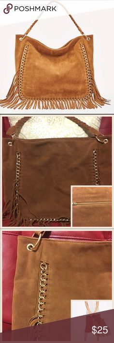 """JustFab Davin Tote JustFab Davin Tote in Cognac..faux suede bag with fringe trim and gold hardware...zip closure..measures 12""""Lx13""""Hx5""""D w/shoulder drop at 12""""... 1 exterior zip pocket ...1 interior zip pocket and 1 interior slip pocket..used on 1 occasion..like new ..no rips/tears/stains ..bag was folded in storage therefore shows signs of small indentations in faux suede as shown in pic 2...color is actual color shown in pic 1 & 3. JustFab Bags Totes"""