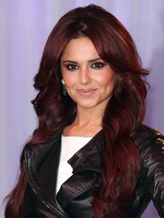 Cheryl Cole's Cherry Cola Hair Color Fomula - 1) Base (all over): 5FR (1oz) Violet Concentrate (1/2oz) Red Concentrate (1/4oz) Mix with: 20 volume Hairmonics activator (1 3/4oz) [CONTINUED] #darkred #haircolor