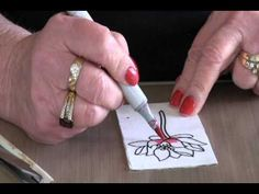 Joan shows how to use the Elizabeth Craft glitter and other products.