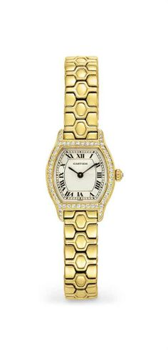 """A diamond and gold """"tortue"""" wristwatch, by Cartier #christiesjewels"""