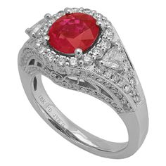 RR29546: An 18K white gold ring with 0.96ct round diamonds, 0.26ct trillion cut diamonds, and a 2.03ct ruby center stone | www.goldcasters.com