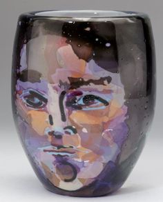 William Bernstein (NC), Art Glass Face Vase blown glass tapered vase decorated with a face in pleasing mauve and peach tones, signed on the bottom and dated 1982.