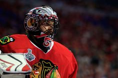 CHICAGO, IL - JUNE 10: Corey Crawford #50 of the Chicago Blackhawks looks on during a break in play against the Tampa Bay Lightning during Game Four of the 2015 NHL Stanley Cup Final at the United Center on June 10, 2015 in Chicago, Illinois. (Photo by Tasos Katopodis/Getty Images)