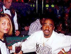 Tupac Shakur & fiance Kidada Jones <3 R.I.P
