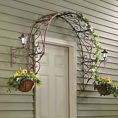 Over-the-Door Arch Trellis from Through the Country Door®. I love this minus the porch lights and the hanging baskets - i'd rather have grapevines or hops climbing this metal arch Garden Art, Garden Design, Home And Garden, Garden Shop, Easy Garden, Dream Garden, Outdoor Crafts, Outdoor Decor, Outdoor Ideas