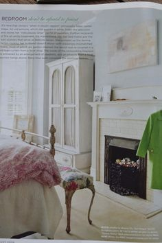 Pale blue walls and pretty bedroom fireplace.