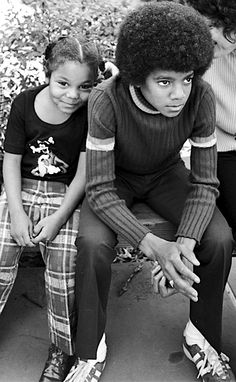 Janet and Michael  Jackson.  Love how they were so young. Reminds me of me and Isaiah as kids. Minus all the money and fame! Lol!