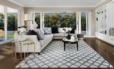 hamptons-style-living-room-with-geometric-rug-and-sectional-sofa