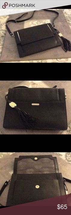 NWOT Vince Camuto Black Leather Crossbody Handbag Beautiful pebbled leather with gold accents and a tassel design detail. Wear this as a casual day purse, detachable straps turns into an evening bag. Has 2 pocket sleeves and a zipper on the inside and a pocket under the flap of the front of the bag. Measurements: length 11 inches, height 8.5 inches, strap length adjusts to 17-20 inches. Or use without straps. Vince Camuto Bags Crossbody Bags