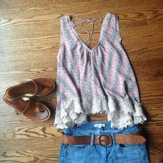 PRICE DROP Free People Flowy Tank XS Free People Flowy Tank XS, in Excellent Used Condition. This amazing tank has great high/low feel! The sides hang lower than the front. Back is lower in the back with completely adjustable fit with the ties. Lace detail is stunning! Free People Tops Tank Tops