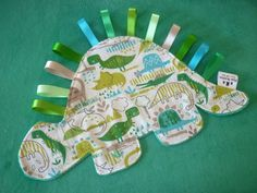 Dinosaur baby comforter - soft blanket toy with tags/ribbons - green/blue…