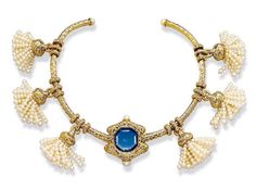 JAR Paris. A SAPPHIRE, ORIENTAL PEARL AND DIAMOND NECKLACES, BY JAR. The centre set with an octagonal-shaped faceted sapphire weighing 18,05 carats within a gold bombé frame, set with diamonds and Oriental pearls, to the similarly-set collar with ring spacers, suspending six Oriental pearl tassels, mounted in 18k gold, made in 1984, 28.0 cm inner circumference, with French assay mark for gold, in a JAR pink leather case. Signed JAR Paris. Estimate $100,000 - $150,000 / UNSOLD. Accompanied…