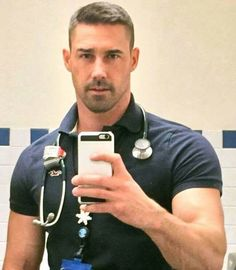 I hate selfies.The only reason he's getting away with it is the uniform. Selfies, Hot Doctor, Male Doctor, Thing 1, Dear Future Husband, Men In Uniform, Male Form, Hairy Men, Bearded Men