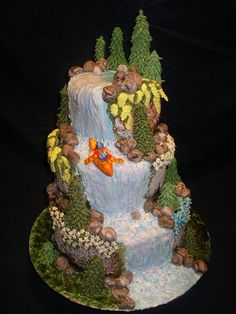 Trees and flowers are made of royal icing. Rocks, kayak and couple are made of fondant. Everything is edible. bimg src=trophy.gif align=absmiddle2006 The Great Outdoors Contest Winner/b