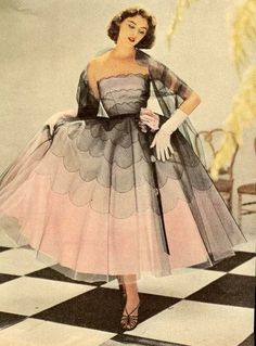 Model wearing a pink and black gown, 1950s