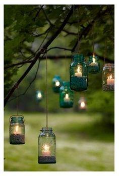 Outdoor lighting - hanging mason jars with candles and sand. I love the idea of using mason jars as decoration. Mason Jar Lighting, Mason Jar Crafts, Uses For Mason Jars, Blue Mason Jars, Outdoor Lighting, Lighting Ideas, Backyard Lighting, Outdoor Candles, Tree Lighting