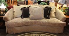 Curved front custom made sofa by Burton James. Sofa has gold & silver damask chenille upholstery w/single cushion seating of down & springs. Sofa includes 6 throw pillows, including 2 brown mohair & 3 gold quilted chenille. - Available at StillGoode! #OnTheShowroomFloor #Curved #Custom #CustomMade #BurtonJames #Burton #James #Gold #Silver #Damask #Chenille #Upholstery #Upholstered #Down #Springs #Pillows #ThrowPillows #Throw #BrownMohair #Mohair #Brown #Gold #Quilted #GoldQuilted #StillGoode