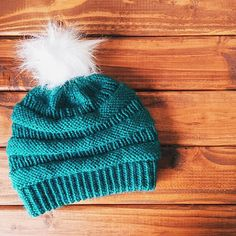"""While in Chicago on a trip, I saw three different people wearing the same style hat. I noticed the first one because I stare at anything knit, whether machine-made or handmade. When I saw the second one, I assumed it must be a coincidence. But after I saw the third one, I turned to my husband and exclaimed, """"I must knit that hat!"""" Then when I went home for a visit and hung out with a hometown friend, she was wearing the same hat I saw in Chicago, and I nearly tore it off her head in…"""