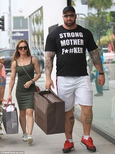 Loading up on Louis Vuitton! At 6ft9in, Game Of Thrones star Hafþór Júlíus Björnsson literally towered over his girlfriend during a shopping trip in Beverly Hills on Thursday