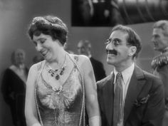 """""""I can see you right now in a hot kitchen, bending over the stove… but I can't see the stove."""" .   Margaret Dumont and Groucho Marx in Duck Soup"""